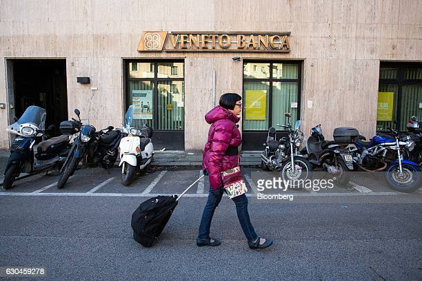 A pedestrian passes a Veneto Banca SpA bank branch in Rome Italy on Friday Dec 23 2016 The nationalization of Banca Monte dei Paschi di Siena SpA...