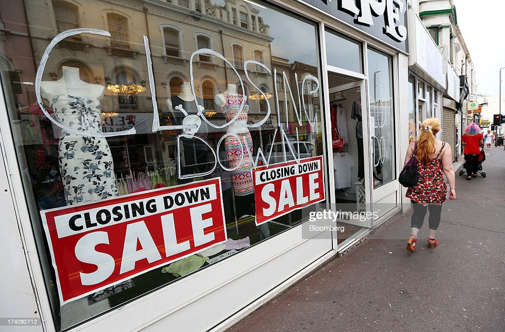 A pedestrian passes a women's clothing store advertising a closing down sale in Hastings, U.K., on Tuesday, July 23, 2013. U.K. retail sales rose for a second month in June as discounts at department stores drove demand for clothes and electrical products. Photographer: Chris Ratcliffe/Bloomberg via Getty Images
