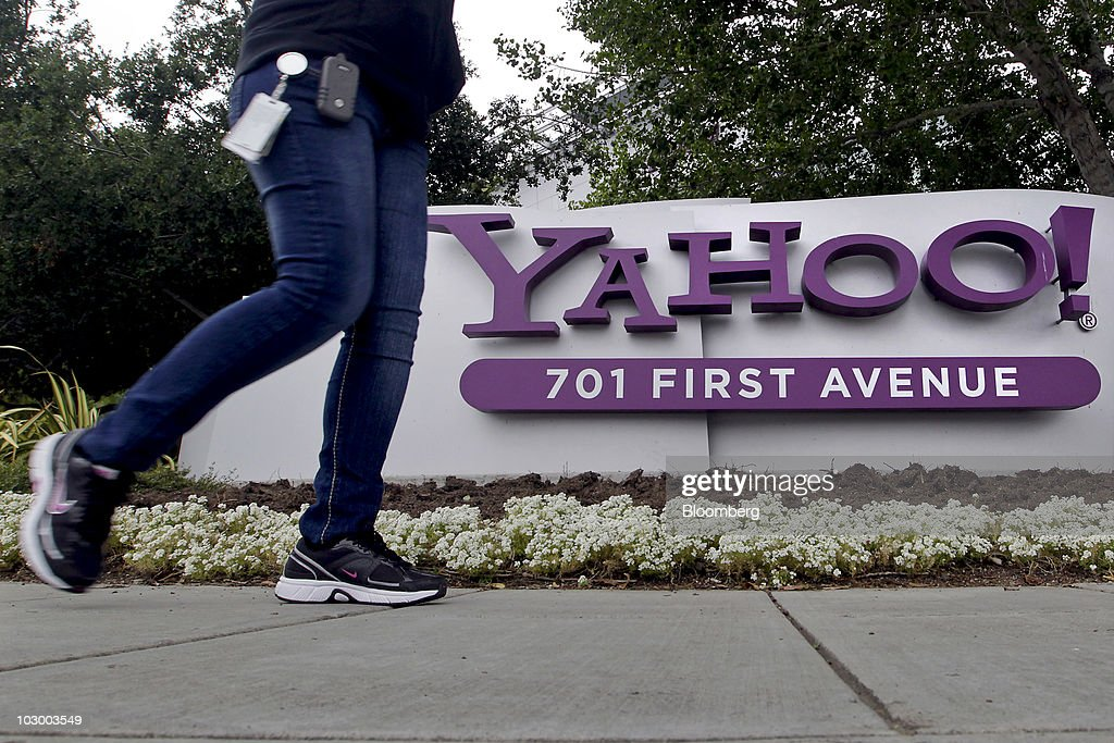 A pedestrian passes a Yahoo sign outside the company's headquarters building in Sunnyvale California US on Tuesday July 2010 Yahoo Inc owner of the...