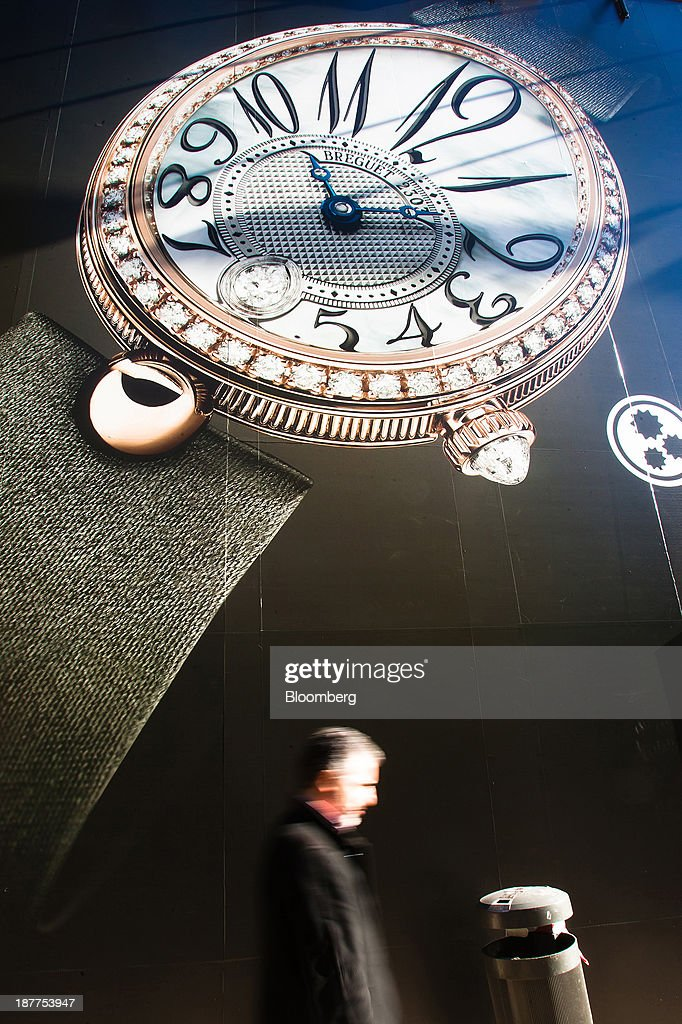 A pedestrian passes an advertisement for Montres Breguet SA watches on a shopping street in Lisbon, Portugal, on Tuesday, Nov. 12, 2013. Portugal's jobless rate dropped for a second quarter, falling to 15.6 percent in the three months through September as the country's economy shows signs of recovery. Mario Proenca/Bloomberg via Getty Images