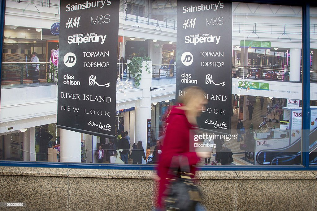 A pedestrian passes an advertisement for the Whitgift Centre shopping mall in Croydon, south London, U.K., on Monday, Feb. 10, 2014. Westfield Group, Australia's biggest mall operator, and Hammerson Plc won preliminary approval to rebuild the Whitgift Centre mall in south London as part of a project valued at about 1 billion pounds ($1.6 billion). Photographer: Jason Alden/Bloomberg via Getty Images
