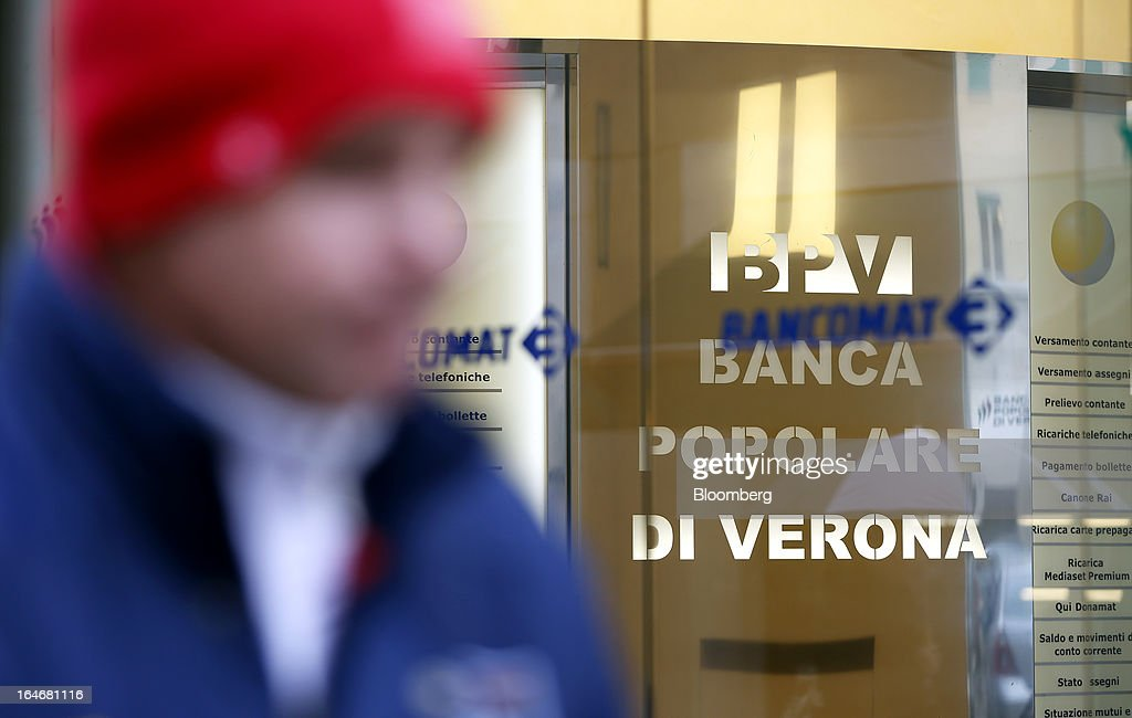 A pedestrian passes an automated teller machine (ATM) at a branch of Banca Popolare di Verona bank, a subsidiary of Banco Popolare SC, in Verona, Italy, on Monday, March 25, 2013. Italy's economy remains mired in its longest recession in two decades and a month-old political impasse threatens to increase sovereign-debt yields and bank funding costs. Photographer Alessia Pierdomenico/Bloomberg via Getty Images