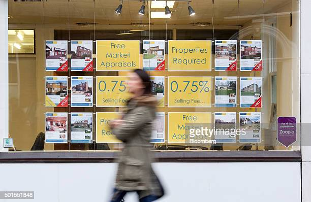 A pedestrian passes an estate agents window in Chelmsford UK on Tuesday Dec 15 2015 UK asking prices rose an annual 74 percent in December amid a...