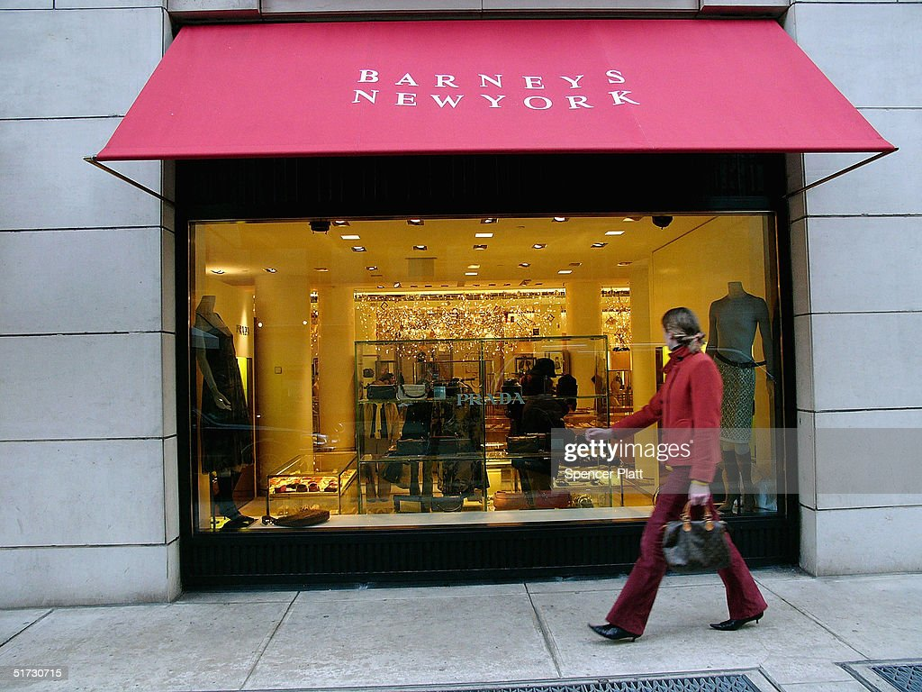 A pedestrian passes Barneys New York November 11 2004 in New York City The Jones Apparel Group has announced a deal to buy Barneys the clothing chain...