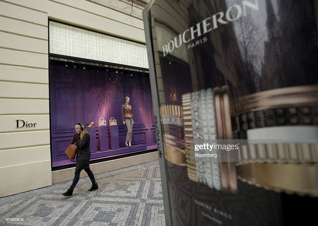 A pedestrian passes between a Christian Dior SA store, left, and a Boucheron jewelry store in central Prague, Czech Republic, on Sunday, Feb. 17, 2013. Worsened outlook for Czech economy is in line with the government's expectations and lower-than-planned tax revenue is 'manageable' under 2013 budget, Prime Minister Petr Necas said on Czech public television. Photographer: Martin Divisek/Bloomberg via Getty Images