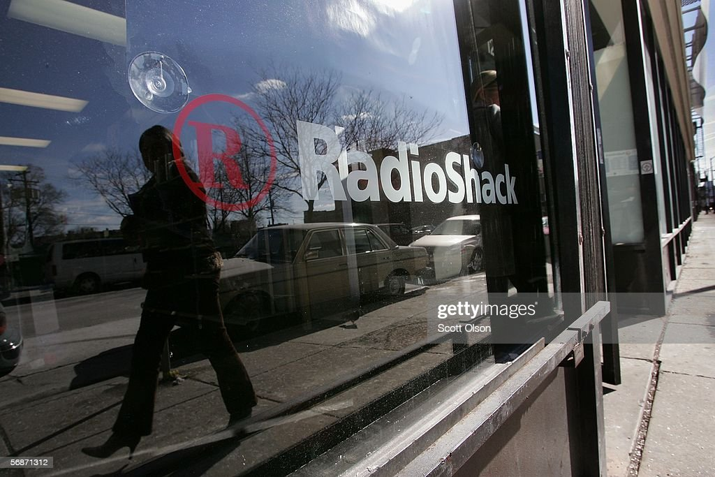 A pedestrian passes by the front of a RadioShack store February 17, 2006 in Chicago, Illinois. The retail chain recently announced that it would close up to 700 company-operated stores. The company also issued an earnings warning, based in part on lowered expectations from the company's wireless business.