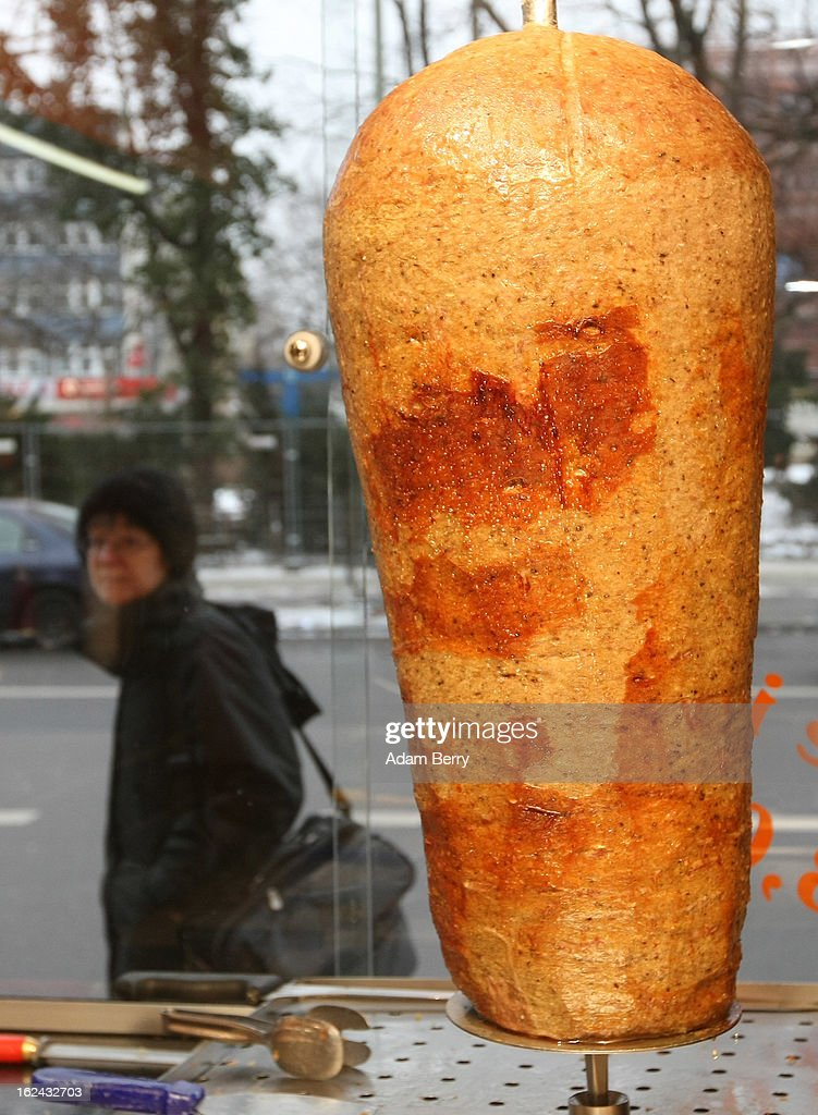 A pedestrian passes Doener kebab meat roasting on a spit at a Doener sandwich shop on February 23, 2013 in Berlin, Germany. The Europe-wide scandal over the contamination of beef products with horsemeat has reached the German capital, where, after laboratory tests, the latter has also been discovered in the city in two Doener sandwich stands and in frozen meat from a discount store. Authorities across the Continent continue to investigate the origin of ready-made lasagne that was labeled to contain only beef when it in fact also contained horsemeat.