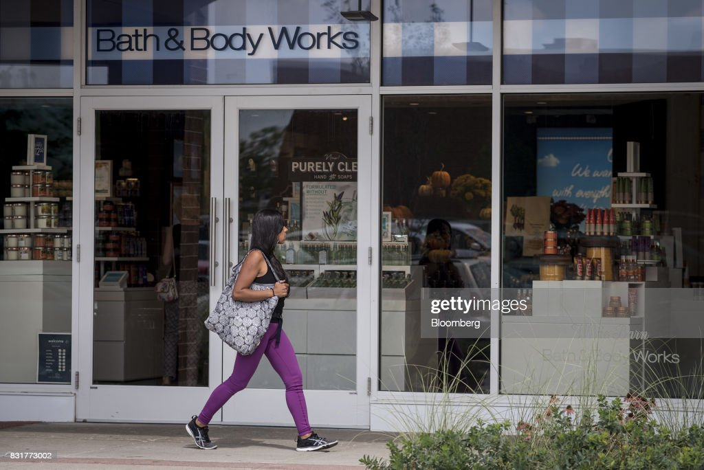 A pedestrian passes in front of a Bath & Body Works LLC store, a subsidiary of L Brands Inc., in Chicago, Illinois, U.S., on Monday, Aug. 14, 2017. L Brands Inc. is scheduled to release earnings figures on August 16. Photographer: Christopher Dilts/Bloomberg via Getty Images