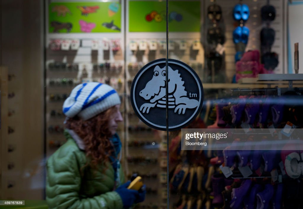 A pedestrian passes in front of a Crocs Inc. store in New York, U.S., on Monday, Dec. 30, 2013. Crocs Inc. rose as much as 14 percent in early trading after saying Chief Executive Officer John McCarvel will retire and Blackstone Group LP will invest $200 million in the maker of colorful plastic clogs. Photographer: Jin Lee/Bloomberg via Getty Images