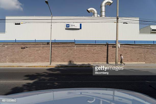 A pedestrian passes in front of a General Motors Co assembly plant in Toluca de Lerdo Mexico on Saturday Jan 7 2017 Presidentelect Donald Trump...