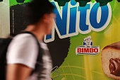 A pedestrian passes in front of a Grupo Bimbo SAB delivery truck in Mexico City Mexico on Thursday July 21 2016 Grupo Bimbo SAB is scheduled to...
