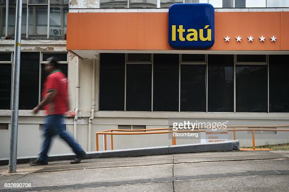 A pedestrian passes in front of a Itau Unibanco Holding SA bank branch in Brasilia Brazil on Wednesday Jan 18 2017 Itau the biggest bank in Latin...