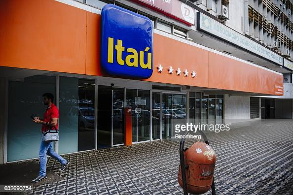 A pedestrian passes in front of a Itau Unibanco Holding SA bank branch in Brasilia Brazil on Friday Jan 20 2017 Itau the biggest bank in Latin...
