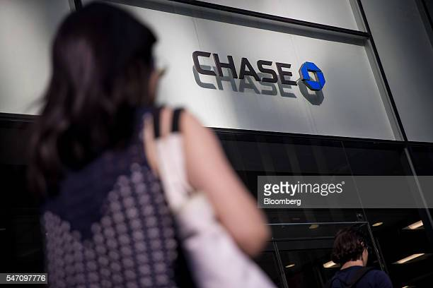 A pedestrian passes in front of a JPMorgan Chase Co bank branch in New York US on Monday July 11 2016 JPMorgan Chase Co is scheduled to release...