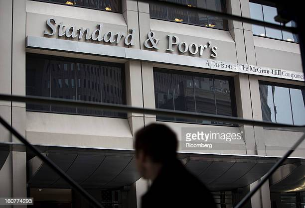 A pedestrian passes in front of Standard Poor's headquarters in New York US on Tuesday Feb 5 2013 The US is seeking as much as $5 billion in...