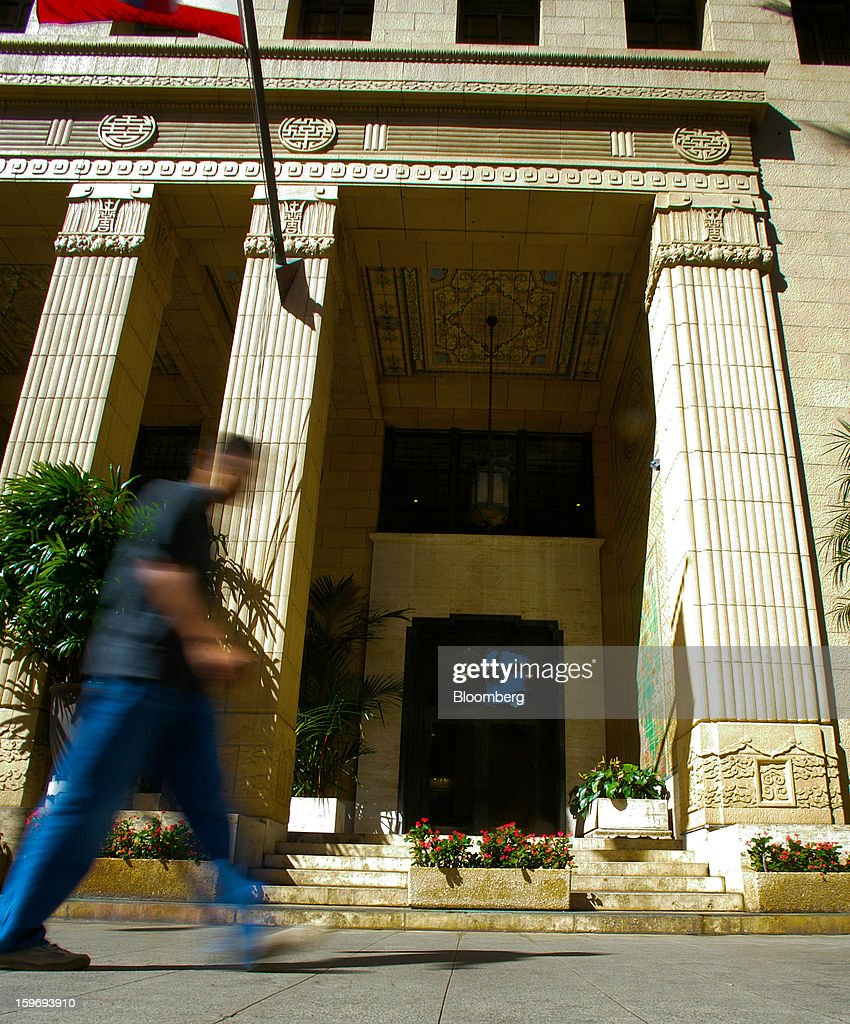 A pedestrian passes in front of the Alexander & Baldwin Inc. offices in Honolulu, Hawaii, U.S., on Wednesday, Jan. 9, 2013. Honolulu, the southernmost major U.S. city, is a major financial center of the islands of the Pacific Ocean. Photographer: Tim Rue/Bloomberg via Getty Images