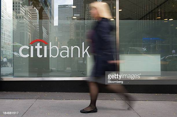A pedestrian passes in front of the Citibank logo displayed on a bank branch on Park Avenue in New York US on Monday Oct 14 2013 Citigroup Inc the...