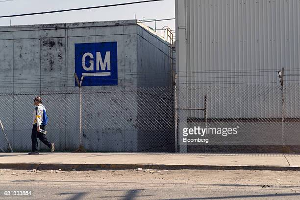 A pedestrian passes in front of the General Motors Co assembly plant in Toluca de Lerdo Mexico on Saturday Jan 7 2017 Presidentelect Donald Trump...