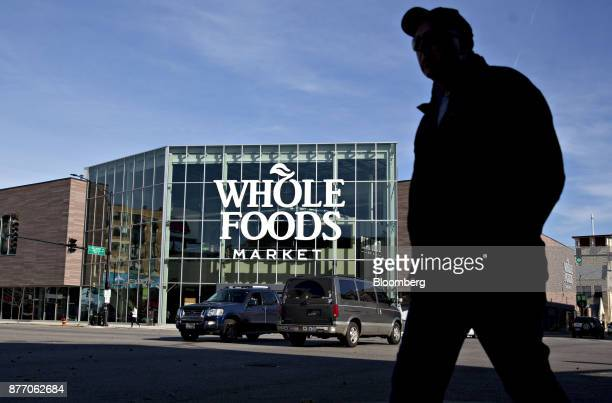 A pedestrian passes in front of the Lakeview Whole Foods Market Inc store in Chicago Illinois US on Monday Nov 20 2017 Amazoncom Inc is betting that...