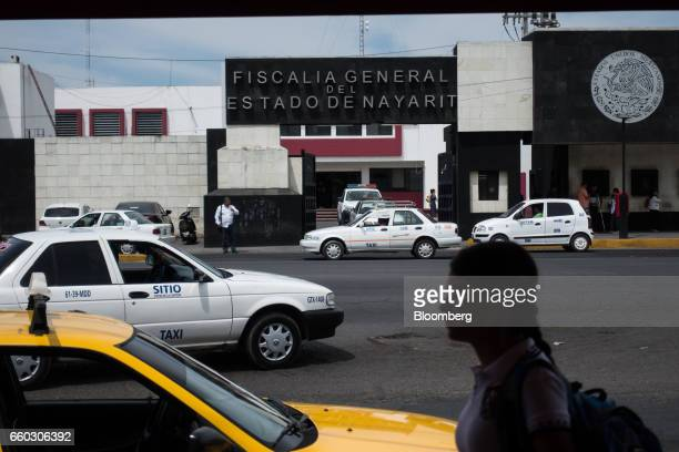 A pedestrian passes in front of the Nayarit State Attorney Generals headquarters in Tepic Mexico on Wednesday March 29 2017 On Wednesday Nayarit...