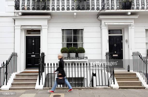 A pedestrian passes luxury residential properties in Knightsbridge in London UK on Tuesday Aug 30 2011 Luxuryhome prices in central London climbed...