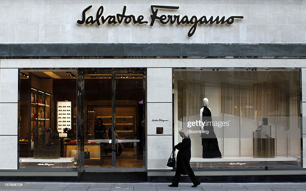 A pedestrian passes Salvatore Ferragamo SpA's Sloane Street store in London, U.K., on Wednesday, Dec. 5, 2012. Demand for Ferragamo's shoes and other items is increasing even as China's economy slows and Europe's debt crisis weighs on consumer spending. Photographer: Simon Dawson/Bloomberg via Getty Images