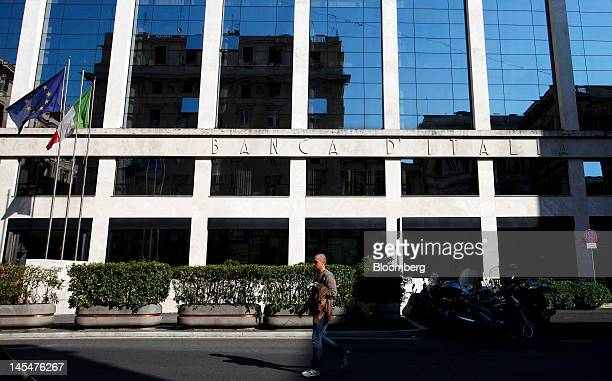 A pedestrian passes the Banca d'Italia Italy's central bank in Rome Italy on Wednesday May 30 2012 Making Italy's labor markets more flexible is key...