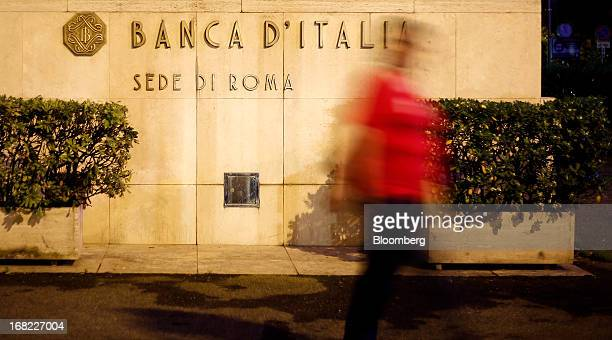 A pedestrian passes the Banca D'Italia Italy's central bank in Rome Italy on Sunday May 5 2013 Italian banks' corporate loan book will worsen this...