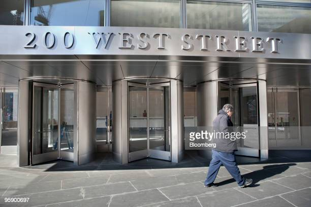 A pedestrian passes the building that will house the new headquarters of Goldman Sachs Group Inc beginning in March at 200 West Street in New York US...