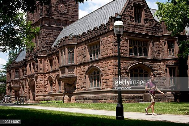 A pedestrian passes the East Pyne building on the Princeton University campus in Princeton New Jersey US on Monday June 21 2010 Princeton University...