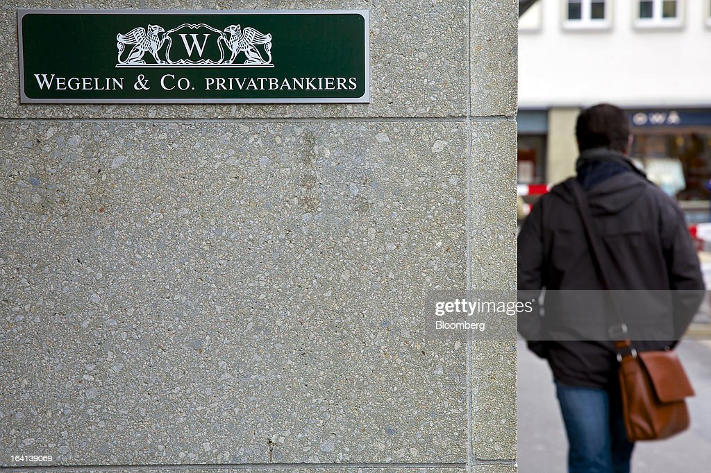 A pedestrian passes the entrance of Wegelin & Co.'s offices in Zurich, Switzerland, on Wednesday, March 20, 2013. Wegelin & Co. were ordered to pay U.S. authorities almost $58 million at the end of a criminal case after the Swiss bank pleaded guilty to helping American taxpayers hide more than $1.2 billion from the Internal Revenue Service. Photographer: Gianluca Colla/Bloomberg via Getty Images