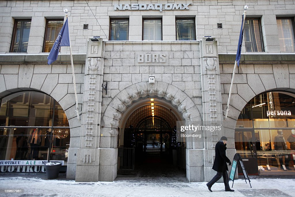 A pedestrian passes the entrance to the Helsinki stock exchange, operated by Nasdaq OMX Group Inc., in Helsinki, Finland, on Thursday, Jan. 17, 2013. Pedestrians pass a display of mobile phones in the window of a Nokia Oyj store in Helsinki, Finland, on Thursday, Jan. 17, 2013. The pace of Finland's debt growth is alarming and the country must undertake economic reforms together with reining in spending, Finnish Prime Minister Jyrki Katainen said in an op-ed piece published in newspaper Savon Sanomat. Photographer: Ville Mannikko/Bloomberg via Getty Images