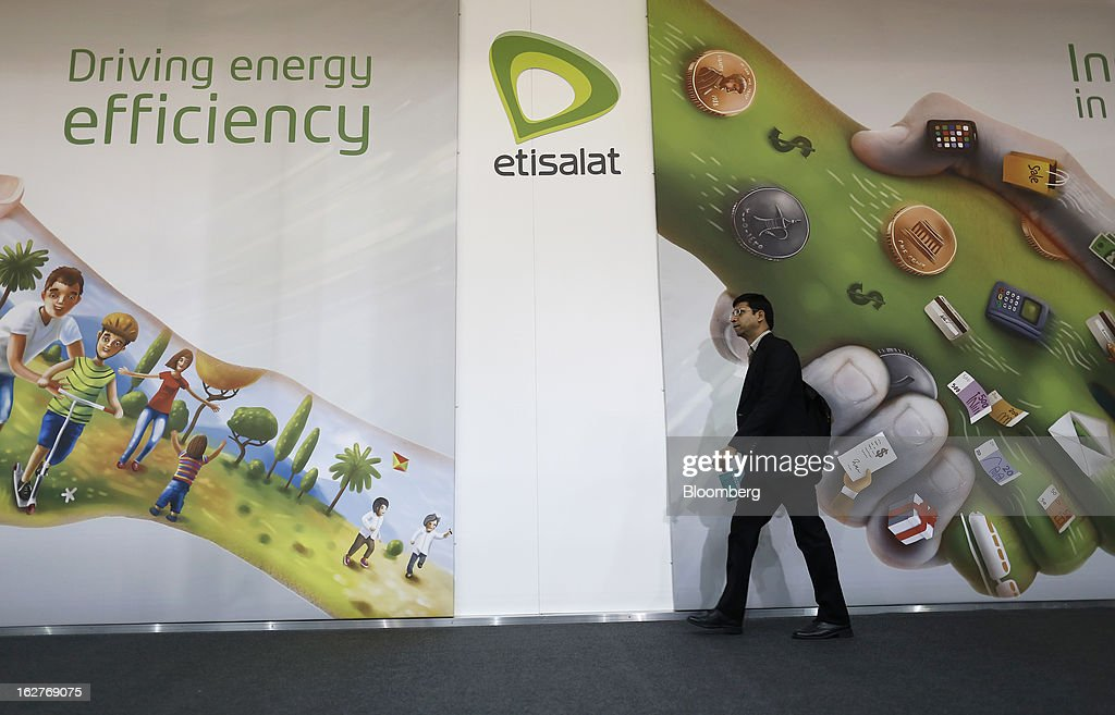 A pedestrian passes the Etisalat pavilion at the Mobile World Congress in Barcelona, Spain, on Tuesday, Feb. 26, 2013. The Mobile World Congress, where 1,500 exhibitors converge to discuss the future of wireless communication, is a global showcase for the mobile technology industry and runs from Feb. 25 through Feb. 28. Photographer: Simon Dawson/Bloomberg via Getty Images