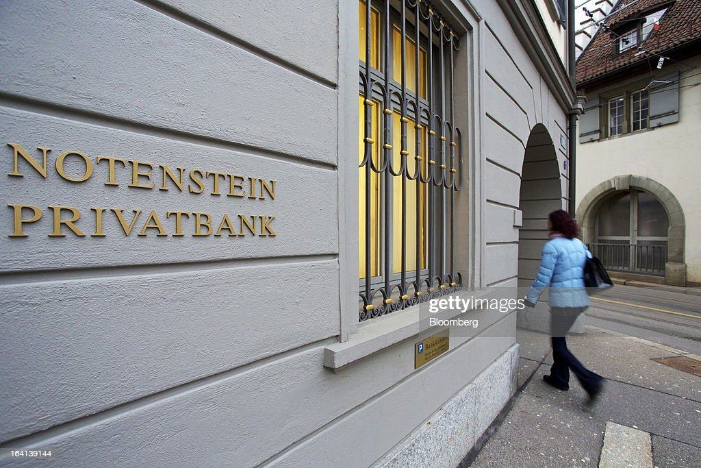 A pedestrian passes the headquarters of Notenstein Privatbank AG, formerly the headquarters of Wegelin & Co., in St. Gallen, Switzerland, on Wednesday, March 20, 2013. Wegelin & Co., who sold Notenstein Privatbank AG to Raiffeisen Group last year, were ordered to pay U.S. authorities almost $58 million at the end of a criminal case after the Swiss bank pleaded guilty to helping American taxpayers hide more than $1.2 billion from the Internal Revenue Service. Photographer: Gianluca Colla/Bloomberg via Getty Images