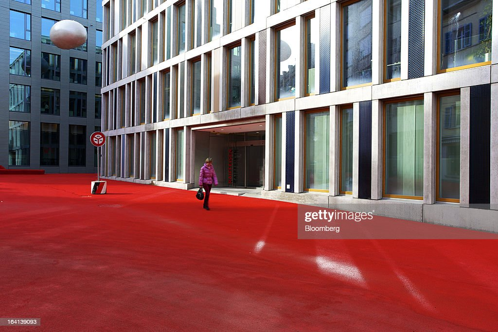 A pedestrian passes the headquarters of Raiffeisen Group in St. Gallen, Switzerland, on Wednesday, March 20, 2013. Wegelin & Co., who sold Notenstein Privatbank AG to Raiffeisen Group last year, were ordered to pay U.S. authorities almost $58 million at the end of a criminal case after the Swiss bank pleaded guilty to helping American taxpayers hide more than $1.2 billion from the Internal Revenue Service. Photographer: Gianluca Colla/Bloomberg via Getty Images