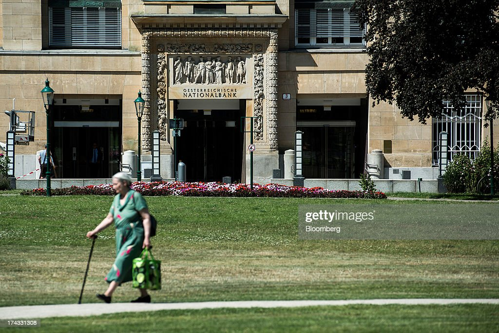 A pedestrian passes the headquarters of the Austrian central bank, also known as the Oesterreichische Nationalbank (OeNB), in Vienna, Austria, on Tuesday, July 23, 2013. Kommunalkredit Austria AG, the Austrian nationalized municipal lender, will have to wind down its loan book and close when that's complete after attempts to sell the bank failed, the European Commission said. Photographer: Akos Stiller/Bloomberg via Getty Images