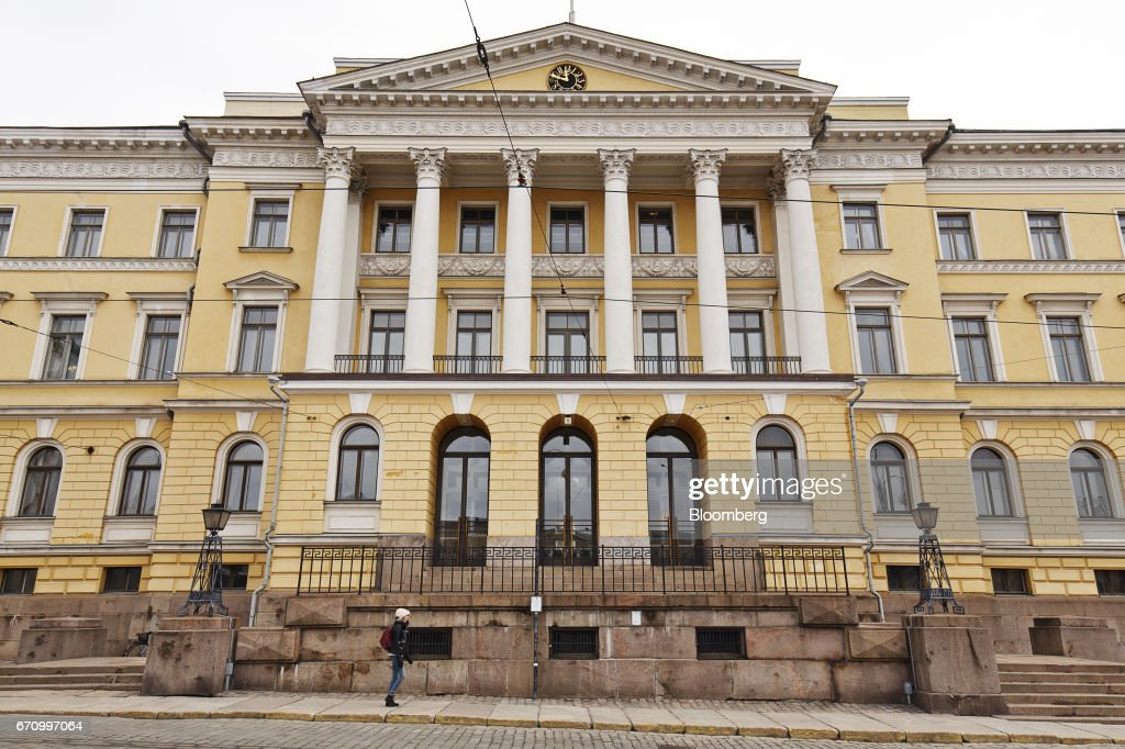 A pedestrian passes the headquarters of the Finnish finance ministry in Helsinki, Finland, on Thursday, April 20, 2017. Instead of showing other EU members how its possible to exit the bloc, the United Kingdom will demonstrate the process involves such immense economic pain that no other country will want to try it out, Orpo said. Photographer: Roni Rekomaa/Bloomberg via Getty Images