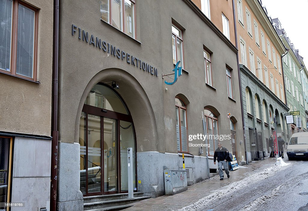 A pedestrian passes the headquarters of the Swedish Financial Supervisory Authority (FSA) in Stockholm, Sweden, on Wednesday, Feb. 13, 2013. Working for a stable financial system is a broad task that ultimately comes down to avoiding financial crises, Andersson said on the agency's website. Photographer: Casper Hedberg/Bloomberg via Getty Images