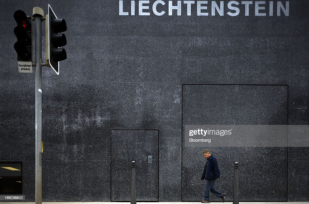 A pedestrian passes the Liechtenstein Museum of Fine Arts in Vaduz, Liechtenstein, on Tuesday, May 21, 2013. Liechtenstein, an alpine principality once fabled for its banking secrecy laws, remains a place favored by billionaires to stash the holding companies and investment entities that control their assets. Photographer: Valentin Flauraud/Bloomberg via Getty Images