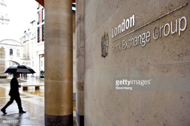 A pedestrian passes the London Stock Exchange in London UK on Wednesday Dec 30 2009 The FTSE 100 has rebounded 55 percent since March 3 as central...