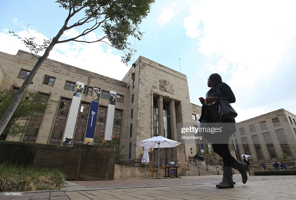 A pedestrian passes the offices of Anglo American Plc in the Marshalltown district of Johannesburg, South Africa, on Friday, Oct. 26, 2012. Anglo American Plc Chief Executive Officer Cynthia Carroll , the first woman, external hire and non-South African to hold the job, will quit after Anglo lost $14 billion in value in the more than five years she was in charge. Photographer: Chris Ratcliffe/Bloomberg via Getty Images