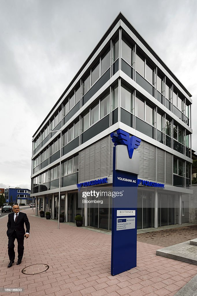 A pedestrian passes the offices of Volksbank AG in Schaan near Vaduz, Liechtenstein, on Tuesday, May 21, 2013. Liechtenstein, an alpine principality once fabled for its banking secrecy laws, remains a place favored by billionaires to stash the holding companies and investment entities that control their assets. Photographer: Valentin Flauraud/Bloomberg via Getty Images
