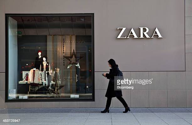 A pedestrian passes the window display of a Zara fashion store operated by Inditex SA at the Odysseum shopping center in Montpellier France on...