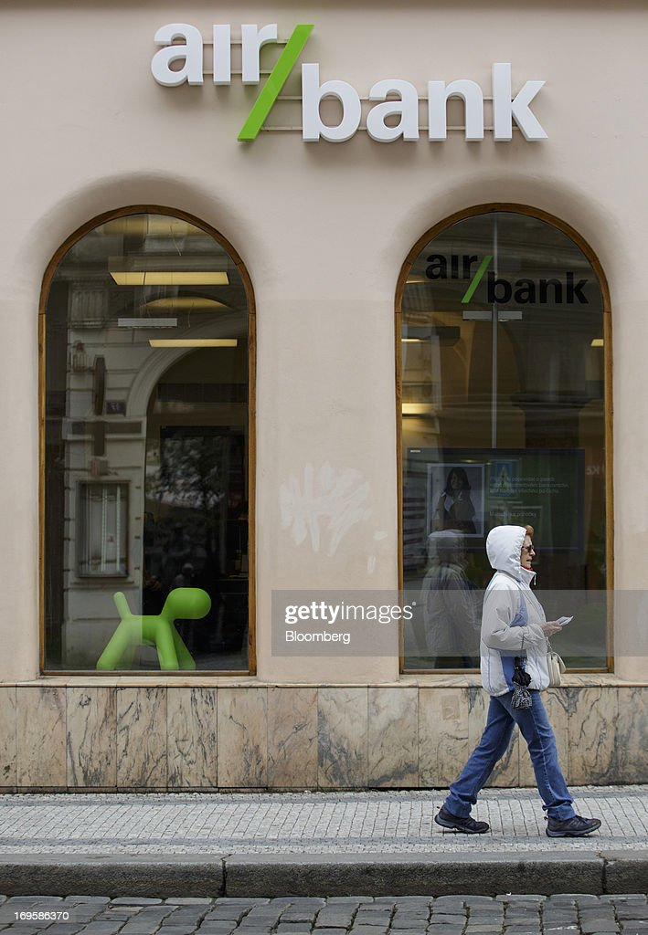 A pedestrian passes the window display of an Air Bank branch in Prague, Czech Republic, on Monday, May 27, 2013. Czech policy makers are in uncharted territory as they debate whether the first koruna sales in a decade are needed to meet their inflation target as the economy has shrunk for five quarters, the longest contraction since at least 1996. Photographer: Martin Divisek/Bloomberg via Getty Images