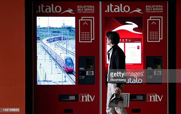 A pedestrian passes ticket vending machines for Italo highspeed trains operated by Nuovo Trasport Viaggiatori SpA at Tiburtina station in Rome Italy...