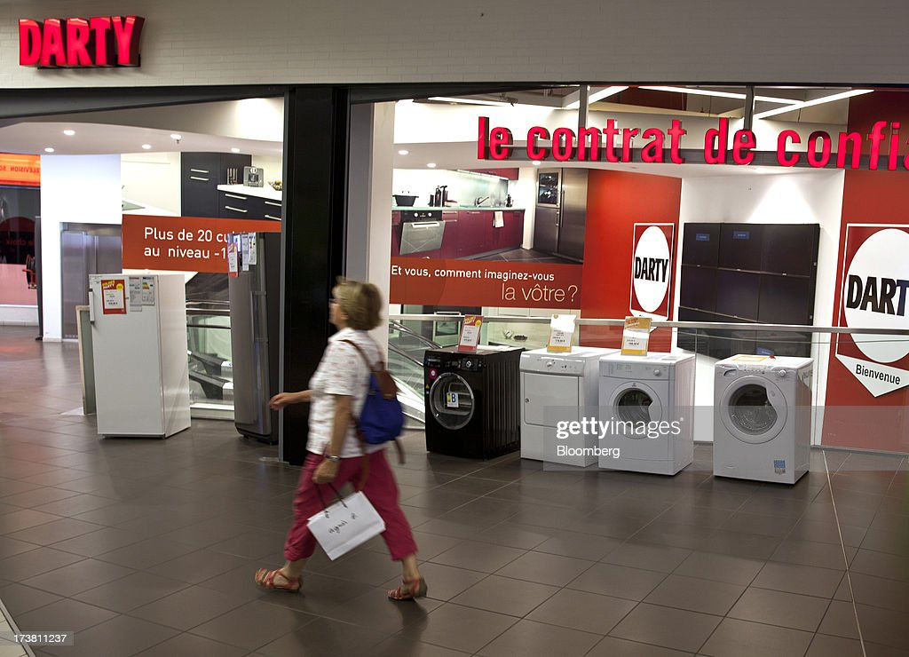 A pedestrian passes washing machines on display outside electronics and furniture store Darty Plc in a shopping mall in Bordeaux, France, on Wednesday, July 17, 2013. Austerity measures and rising unemployment are restraining consumer spending in Europe, while retailers including Groupe Auchan SA and Casino Guichard-Perrachon SA are competing more aggressively on price. Photographer: Balint Porneczi/Bloomberg via Getty Images