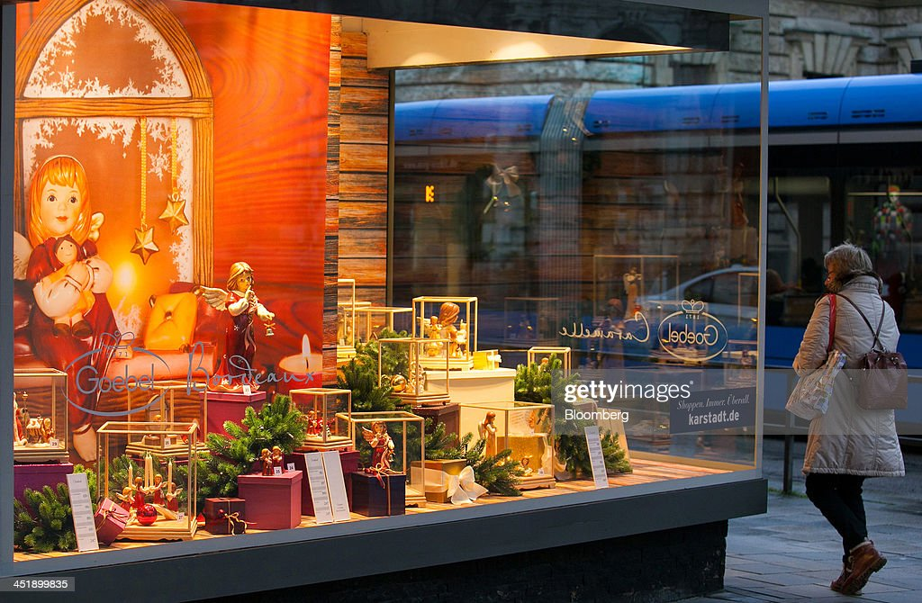 A pedestrian passes window display for Christmas goods on display at a Karstadt Warenhaus GmbH department store in Munich, Germany, on Sunday, Nov. 24, 2013. In Germany, Europe's biggest economy, annual consumer prices increased 1.2 percent in October. Photographer: Krisztian Bocsi/Bloomberg via Getty Images