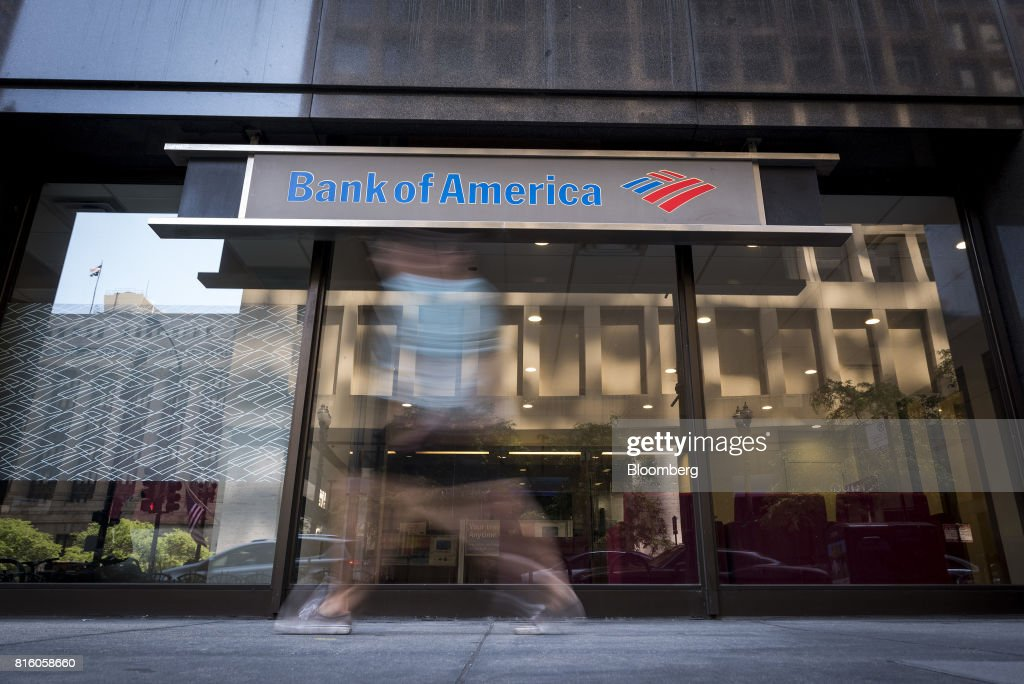 A pedestrian photographed with a slow shutter speed is seen passing in front of a Bank of America Corp. branch in Chicago, Illinois, U.S., on Saturday, July 8, 2017. Bank Of America Corp. is scheduled to release earnings figures on July 18. Photographer: Christopher Dilts/Bloomberg via Getty Images