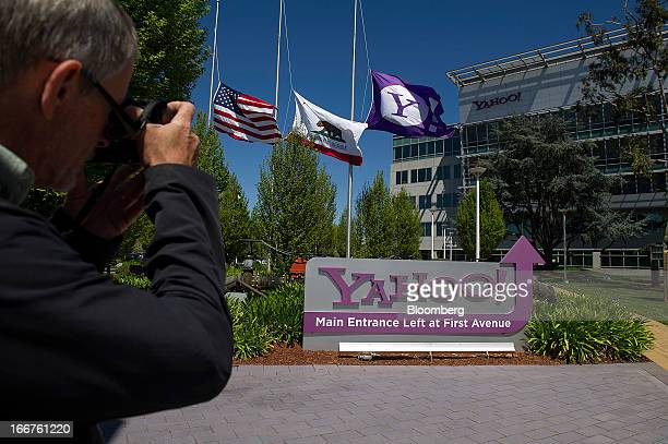 A pedestrian photographs Yahoo Inc signage displayed at the company's headquarters in Sunnyvale California US on Tuesday April 16 2013 Yahoo Inc the...