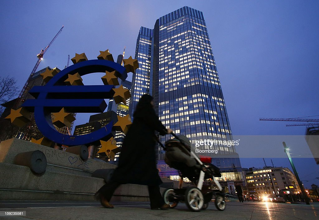 A pedestrian pushes a baby stroller past the European Central Bank (ECB) headquarters in Frankfurt, Germany, on Wednesday, Jan. 9, 2013. German two-year notes declined, pushing yields to the highest in 11 weeks, after European Central Bank President Mario Draghi said the decision to leave the key interest rate at 0.75 percent was 'unanimous.' Photographer: Ralph Orlowski/Bloomberg via Getty Images